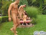 Hot and horny brunette Evelyn wanders around a big green park as she isjoined by three hung studs. Their hard dicks enjoy the knob polishing ...