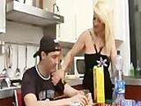 Blond chubby housewife seducing younger guy in the kitchen and she bouncing on his big cock in the bedroom