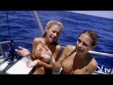 Naked badass babes facing sharks in a cage submerged in the ocean and riding SeaDoo jet ski topless!
