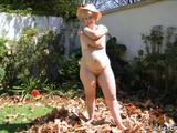 Older mature granny senior gets horny while working in the garden